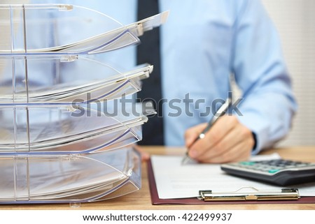 Many documents  arranged in a file shelves, paperwork and accounting - stock photo