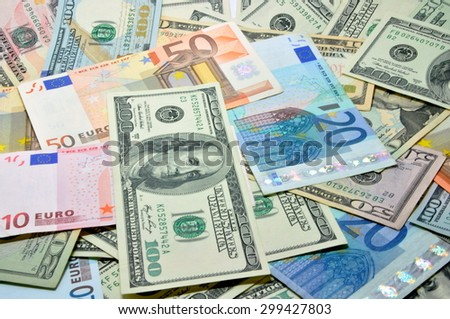 many dollar and euro, close-up - stock photo