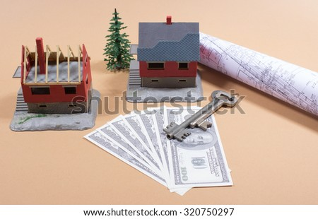 Many dollar banknotes, key and a house model. - stock photo