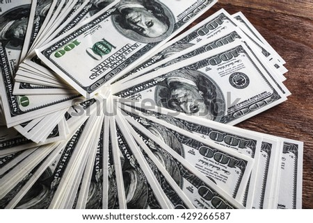 Many 100 dollar bills. Money as background. - stock photo