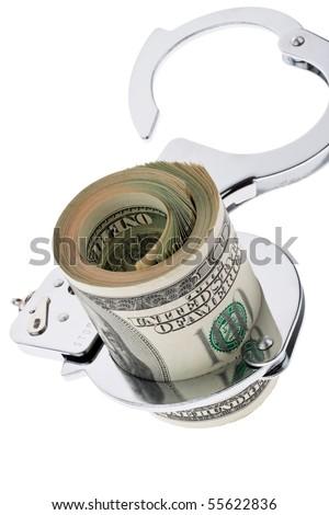 Many dollars bills with handcuffs - stock photo