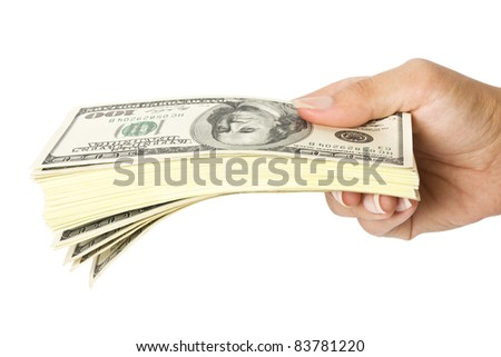 Many dollars falling on womans hand with money - stock photo