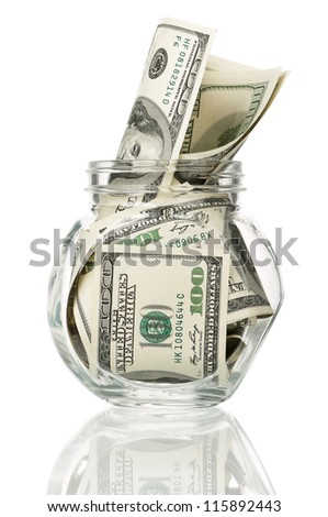 Many dollars in a glass jar isolated on white background - stock photo