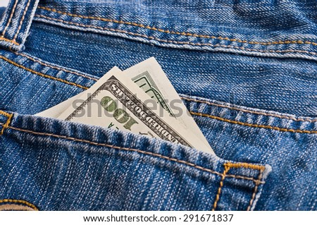 Many Dollars in the pocket of jeans - stock photo