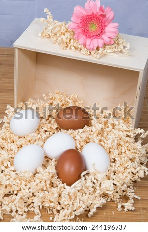 Many eggs in a wooden box - stock photo
