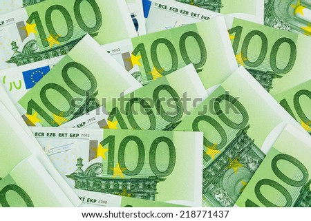 many einhhundert euro banknotes lie side by side. symbol photo for wealth and investment - stock photo
