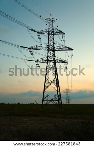 Many electric towers against dusk sky - stock photo