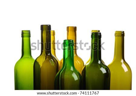 Many empty green wine bottles isolated on white background - stock photo