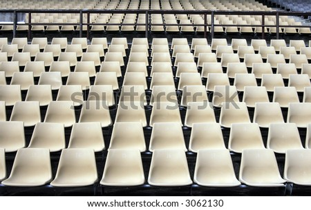 Many Empty Seats In Rows In An Outdoor Stadium - stock photo