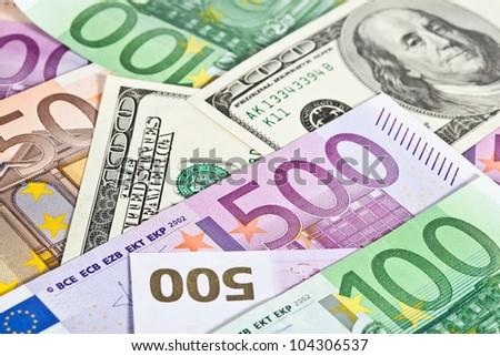 Many euro and dollar banknotes, money background - stock photo