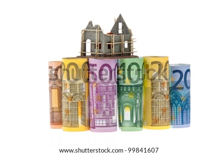 many euro bank notes with shell building - stock photo