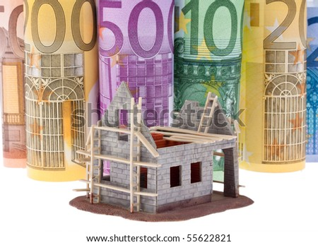 Many Euro bank notes with shell house - stock photo
