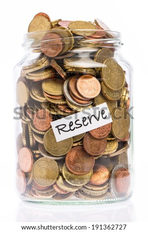 Many Euro coins in a jar as a reserve - stock photo