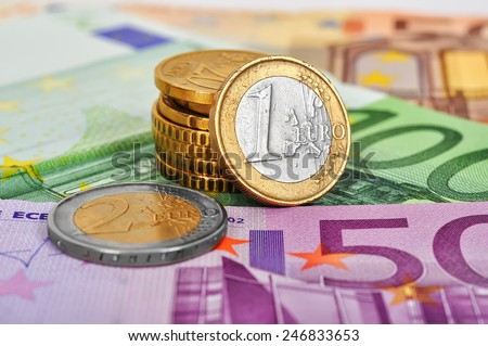 many euro coins money and bills, close up - stock photo