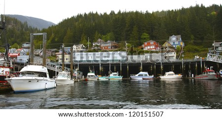 Many fishing boats docked at a harbor in Alaska - stock photo