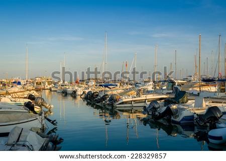 Many fishing boats stays at bertch in Eivissa, Spain - stock photo
