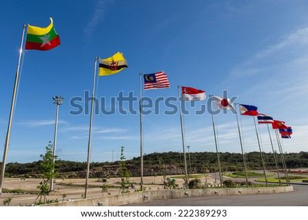 many flags of asean countries are flying on towers - stock photo