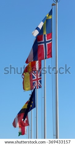 many flags of many nations world waving in the sky - stock photo