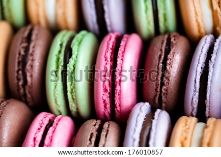 Many french colorful macarons on the photo - stock photo