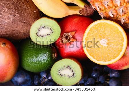 Many fresh colorful fruits backround - stock photo