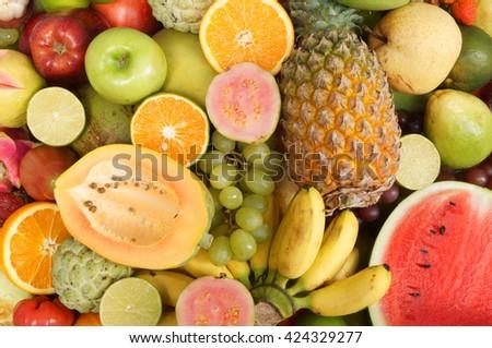 Many fresh fruits mixed, fruits background - stock photo