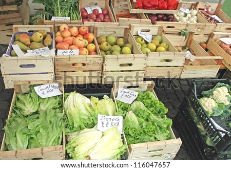 many fruit crates on sale vegetable market with vegetables - stock photo