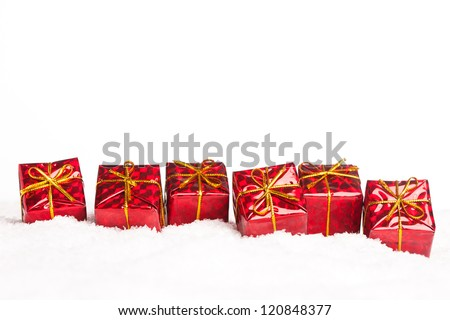 many gift boxes in snow - stock photo
