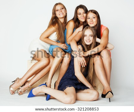 many girlfriends hugging celebration on white background, smiling talking chat, girl next door cool - stock photo