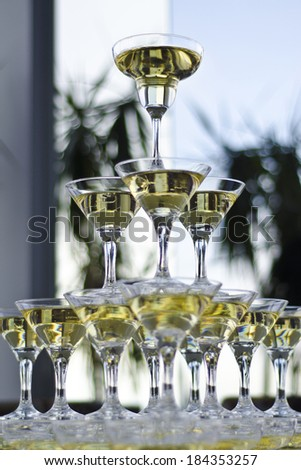 many glasses of champagne in the form of slides - stock photo