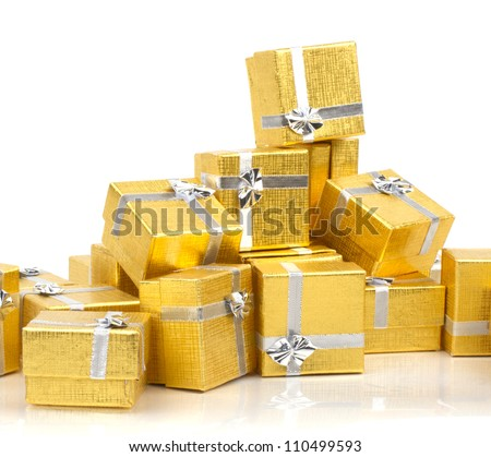 Many gold gifts in a pile - stock photo