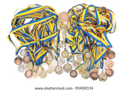 Many gold, silver, and bronze medals isolated on white background - stock photo