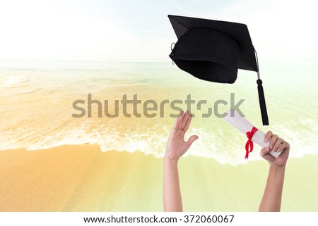 Many hand holding graduation hats on background of blue sky (Vintage) - stock photo
