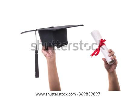 Many hand holding graduation hats on White background - stock photo