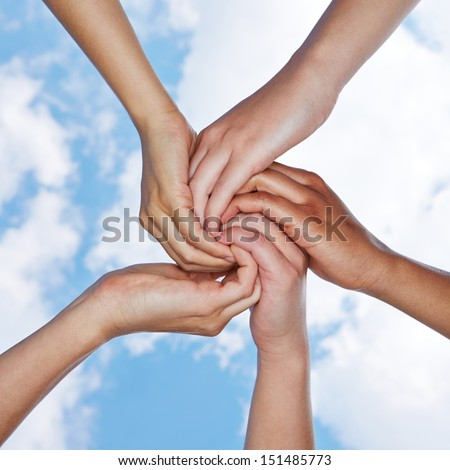 Many hands connecting for help in a spiral under a sky - stock photo
