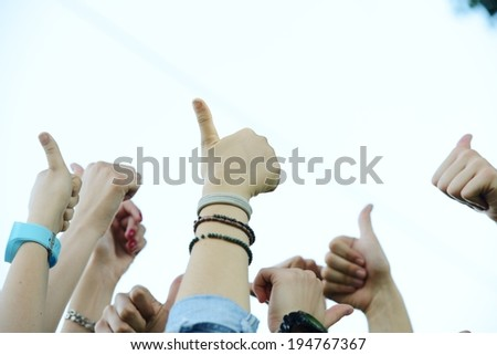 Many hands giving thumbs up - stock photo