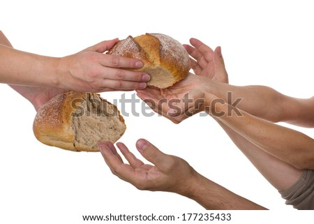 Many hands grabbing for bread - stock photo