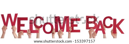 Many Hands Holding a Red Welcome Back, Isolated - stock photo