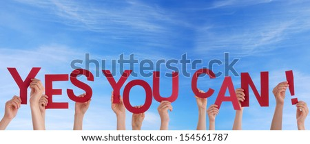 Many Hands Holding the Words Yes You Can in the Sky - stock photo