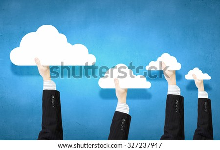 Many hands of business people holding cloud concept - stock photo