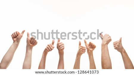 Many hands showing thumb up signs on white background - stock photo