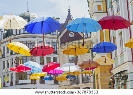 Many hanging colorful umbrellas hanging above the head - stock photo