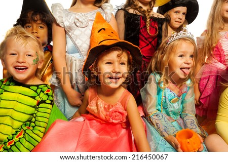 Many happy kids in Halloween costumes - stock photo