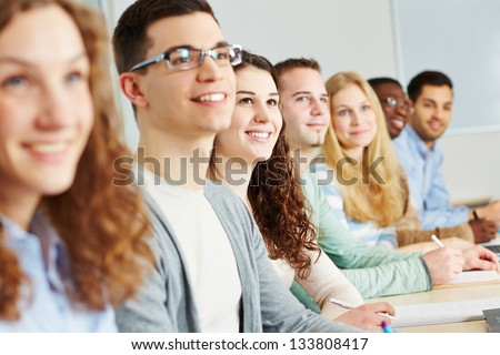 Many happy students learning in university of applied sciences - stock photo