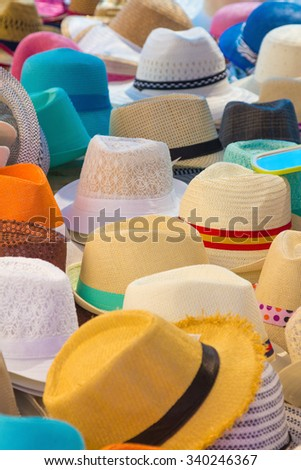 Many Hats of all colors for summer - stock photo
