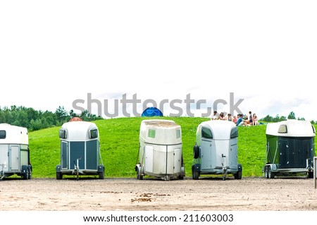 Many horse trailers in the summer park. Outdoors. - stock photo