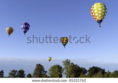 Many hot air balloons floating in the sky - stock photo