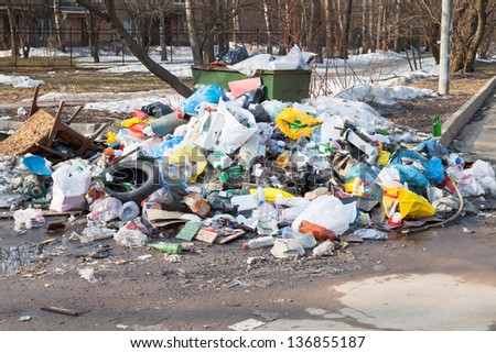 many household garbage and urban dumpster - stock photo