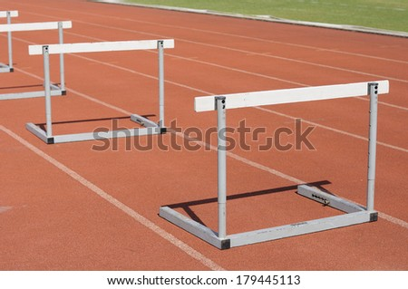 Many hurdle races on race tracks - stock photo