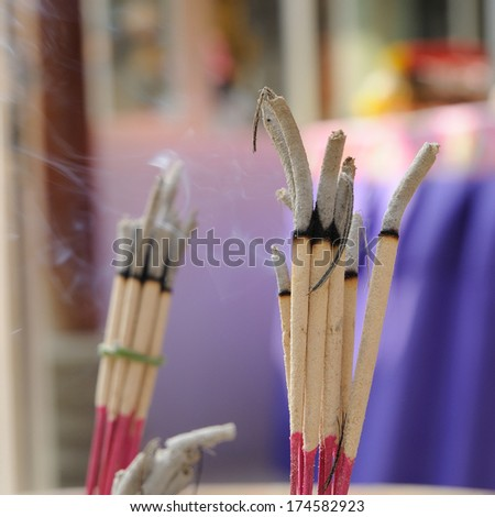 Many joss-sticks burning in censer. - stock photo