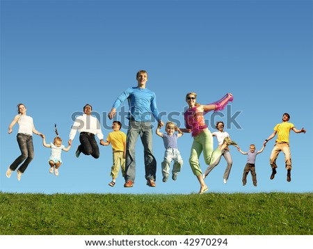 Many jumping families on the grass, collage - stock photo